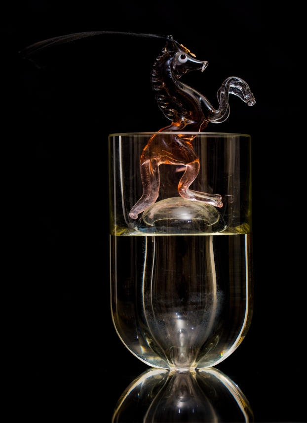 Mimi Berlin, 2013. History of Circus Legends.. Glass Horse. (1980s mouthblown glass, feather, metal, glass) ø 5,5 x 13 cm