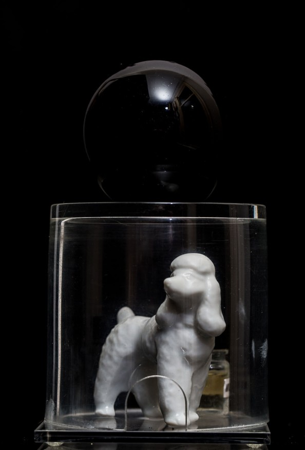 "Mimi Berlin, 2013. History of Circus Legends. Escape Artist or Shrinking Poodle.(ceramic, glass, perspex, perfume ""Munich"") 8.5 x 13.5 cm,"