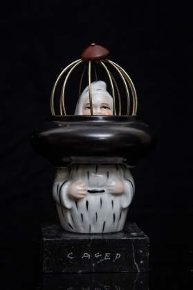 Fat Caged Pierrot Assembled (1930s porcelain/1970s ceramic/resin/metal/marble) 9 x 15 cm