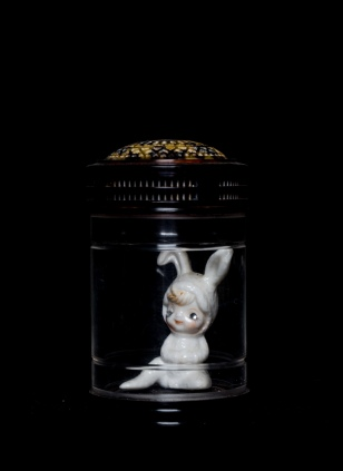 Mimi Berlin, 2014. Caged Hybrid. (Assembled 1950s porcelain/plastic jar with room for oxyen, signed with a Chinese character) ø 6 x 9,5 cm.)